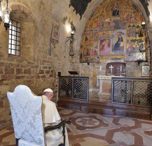 Pope Francis prays in the chapel beloved by Saint Francis.