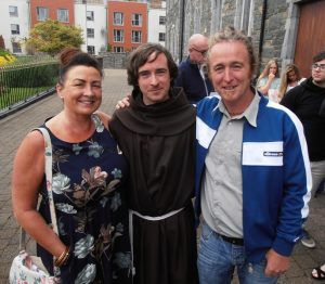 Brother Dáraigh with his parents.